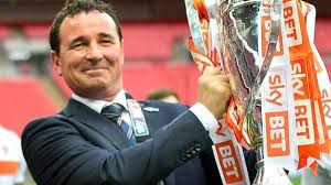 Gary Bowyer holding SkyBet trophy